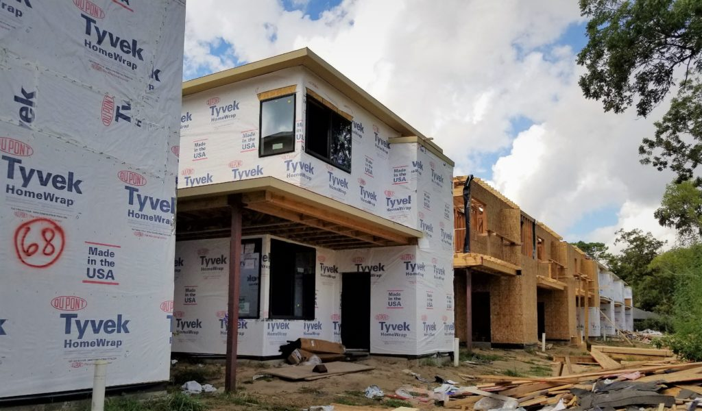 Affordable new construction Avenue homes, some with Home Wrap, some with just OSB panels.