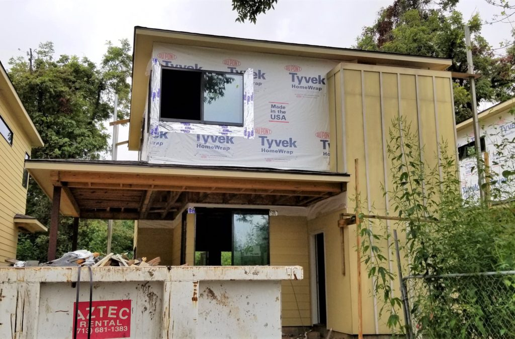 Affordable new construction Avenue home with fiber cement board partially installed.